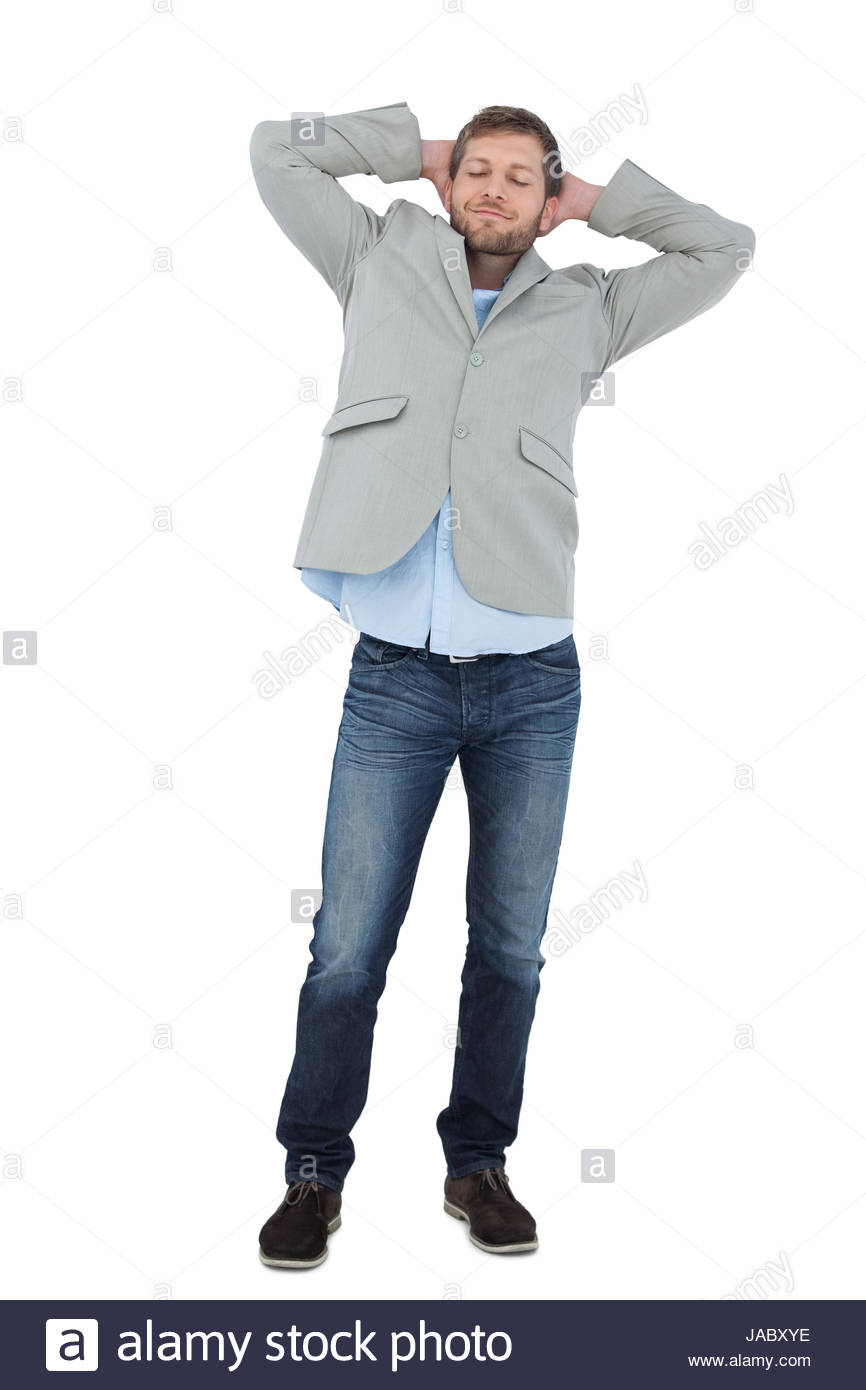 Suave man in a blazer with hands behind head on white background 866x1390