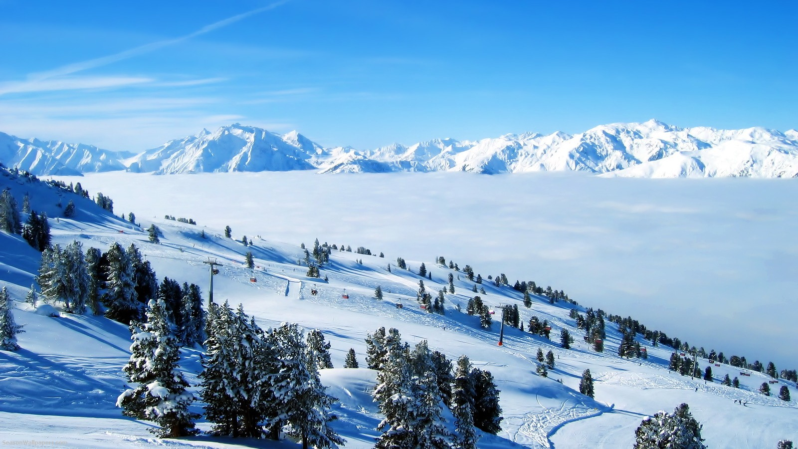 ski slopes are covered with snow above the clouds Properties 1600x900