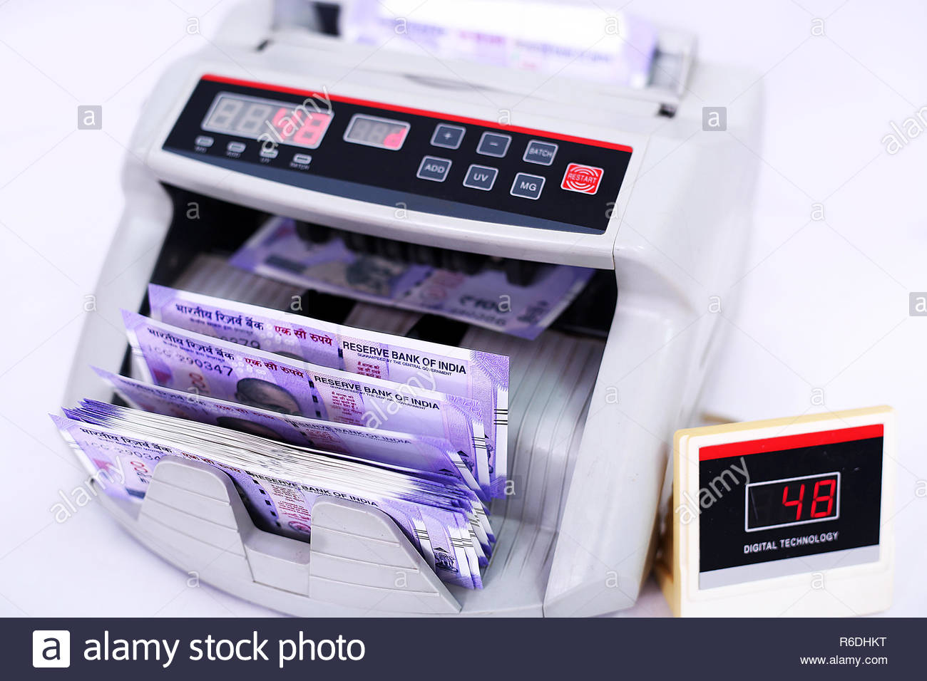 Money counting machine for Indian banknote machine Isolated on 1300x956
