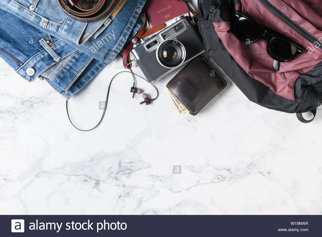 prepare backpack accessories and travel items for summer on marble 1300x956