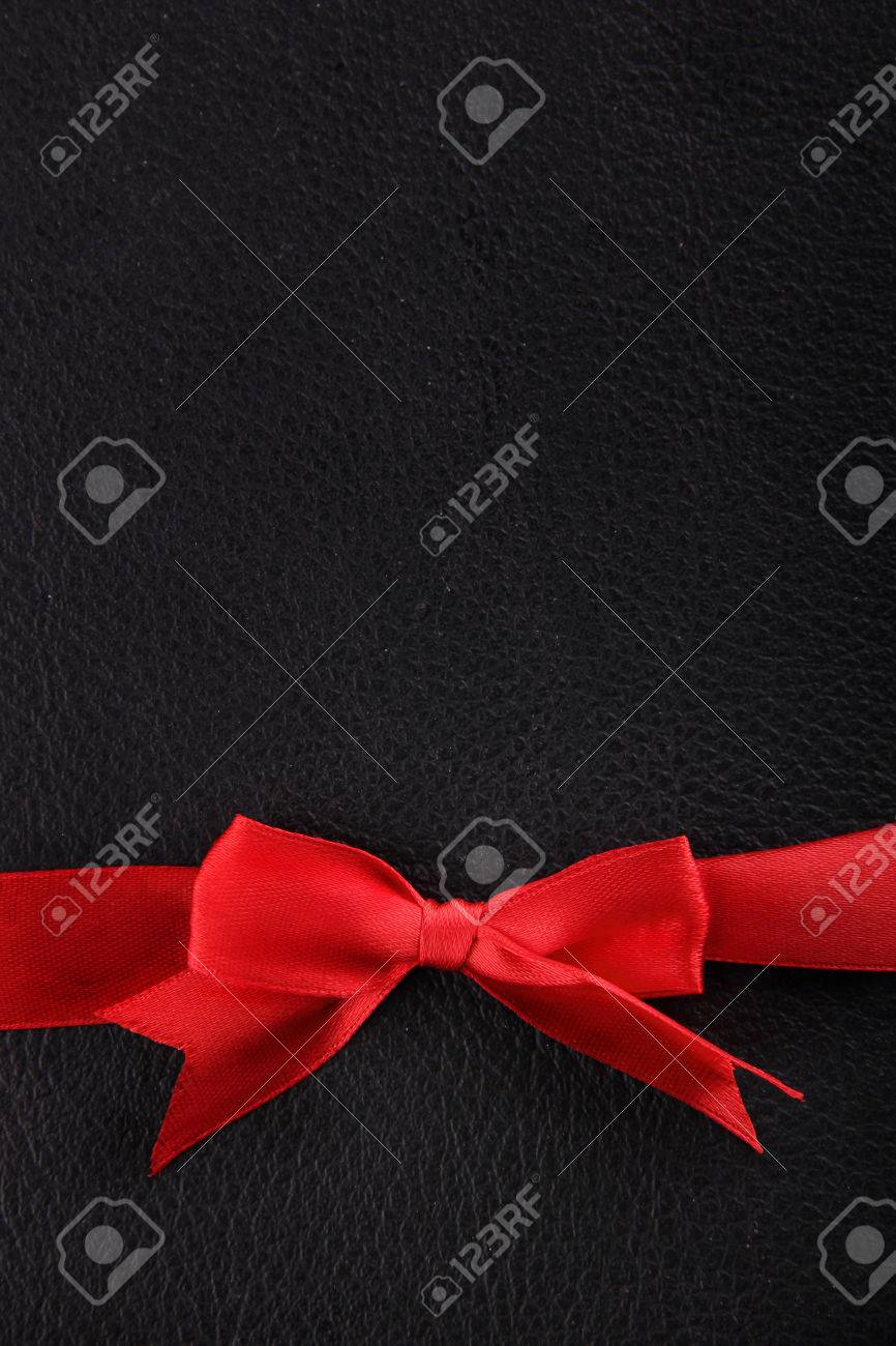A Red Ribbon On The Lower Side Of Black Leather Background Stock 866x1300