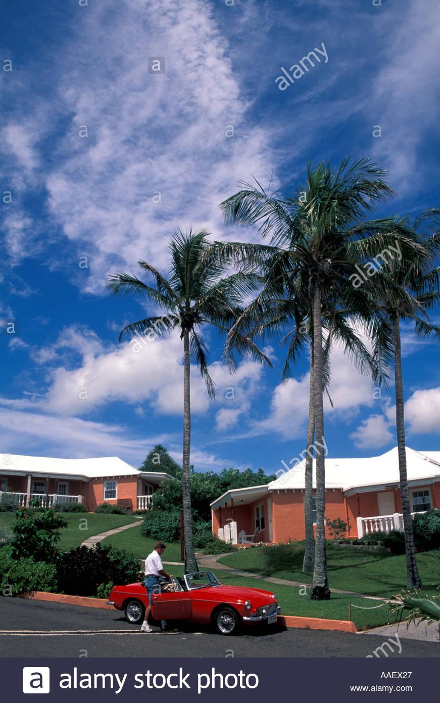 Bermuda Ariel Sands Resort pink buildings palm trees blue sky 871x1390