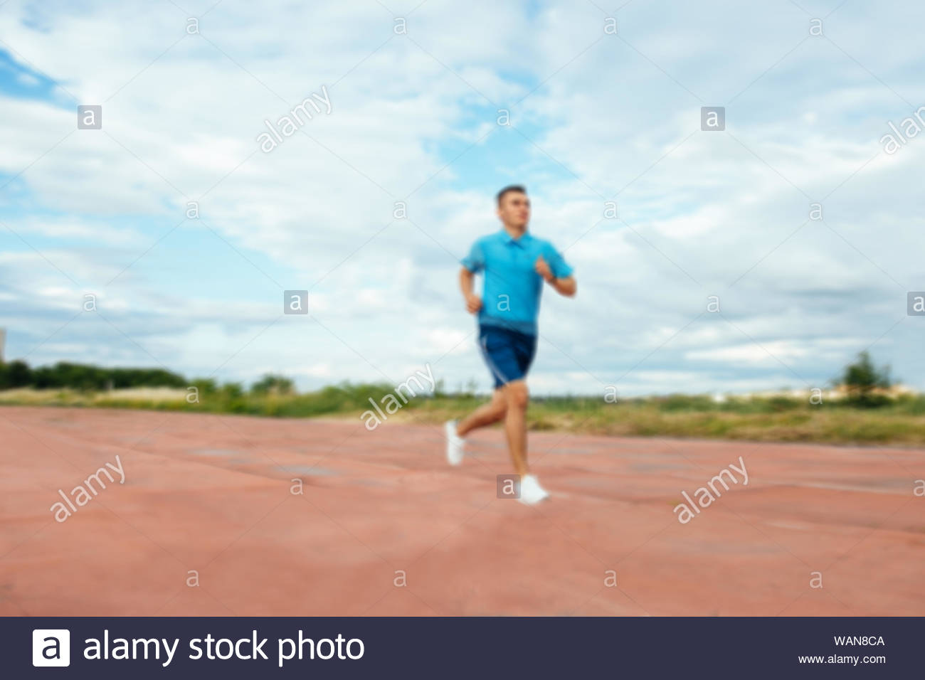 Young handsome active sportsman running on track field blurred 1300x956