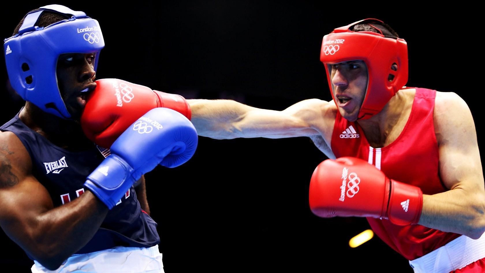 Armenian Hakobyan punching Gausha Boxing 2012 Olymics HD Wallpaper 1680x945