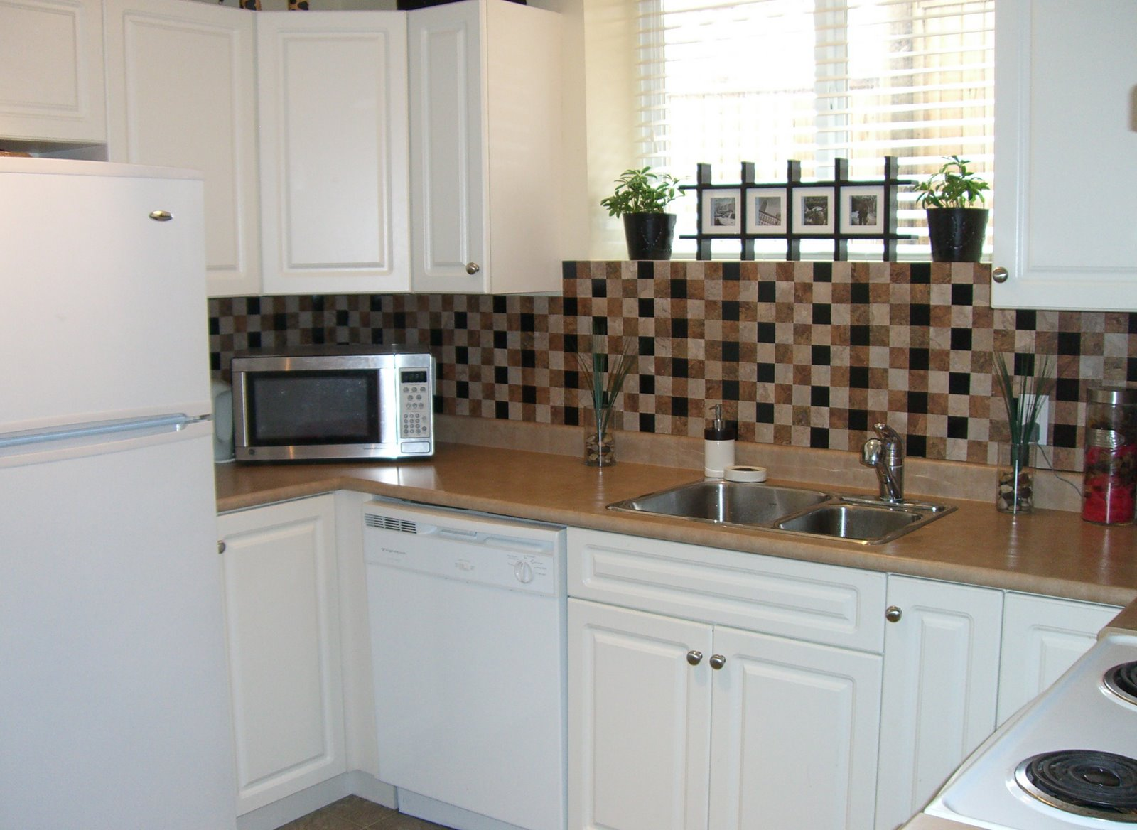 black tiles because we didn t want the black to take over the kitchen 1600x1168