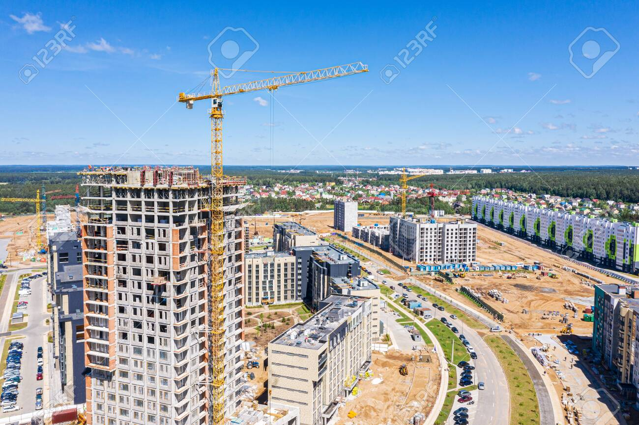 Construction Site With Highrise Building And Cranes On Blue Sky 1300x866