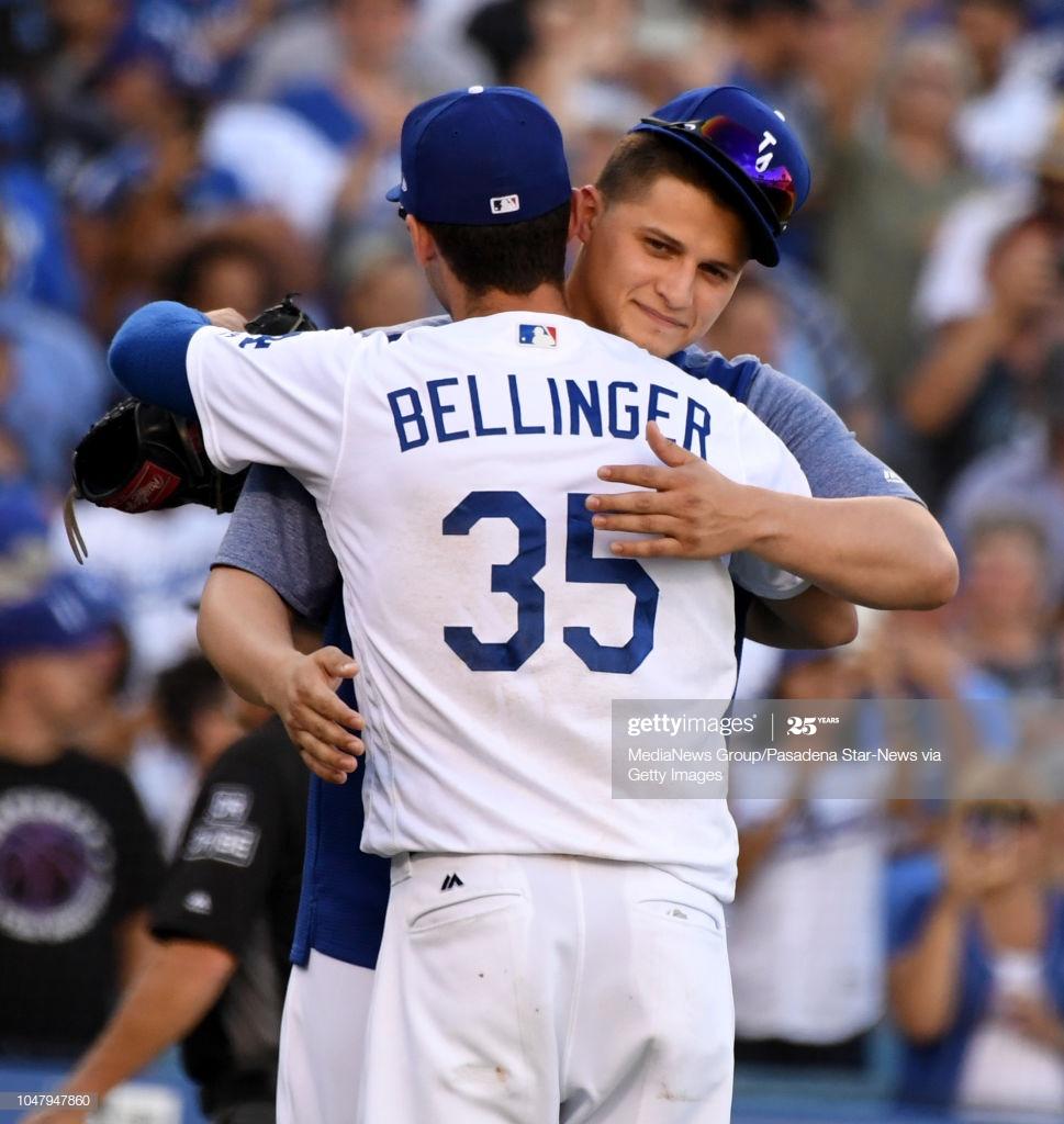 Cody Bellinger of the Los Angeles Dodgers hugs teammate Corey 969x1024