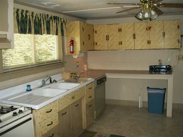 wallpaper placed over kitchen cabinet drawer doors fixer upper Macon 640x480
