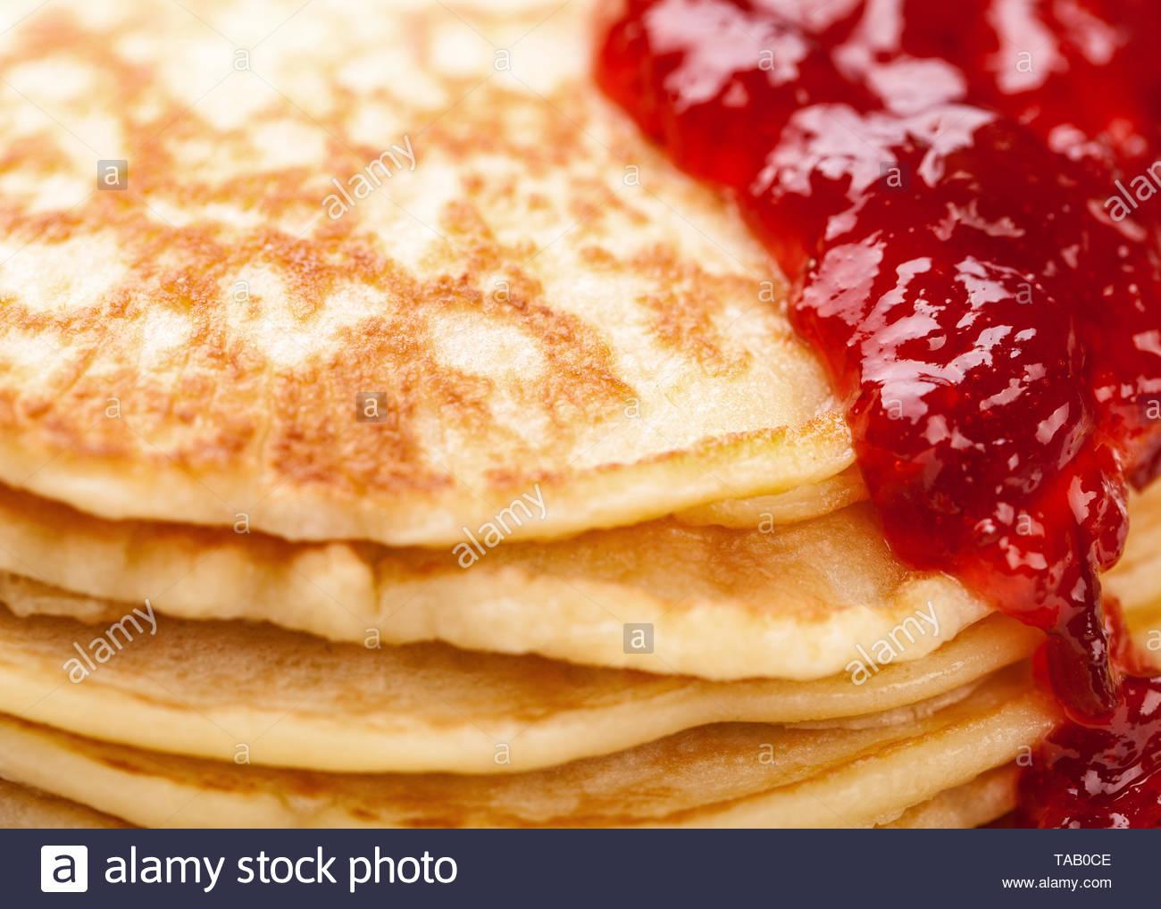 pancakes background with strawberry jam Stock Photo 247333534   Alamy 1300x1018