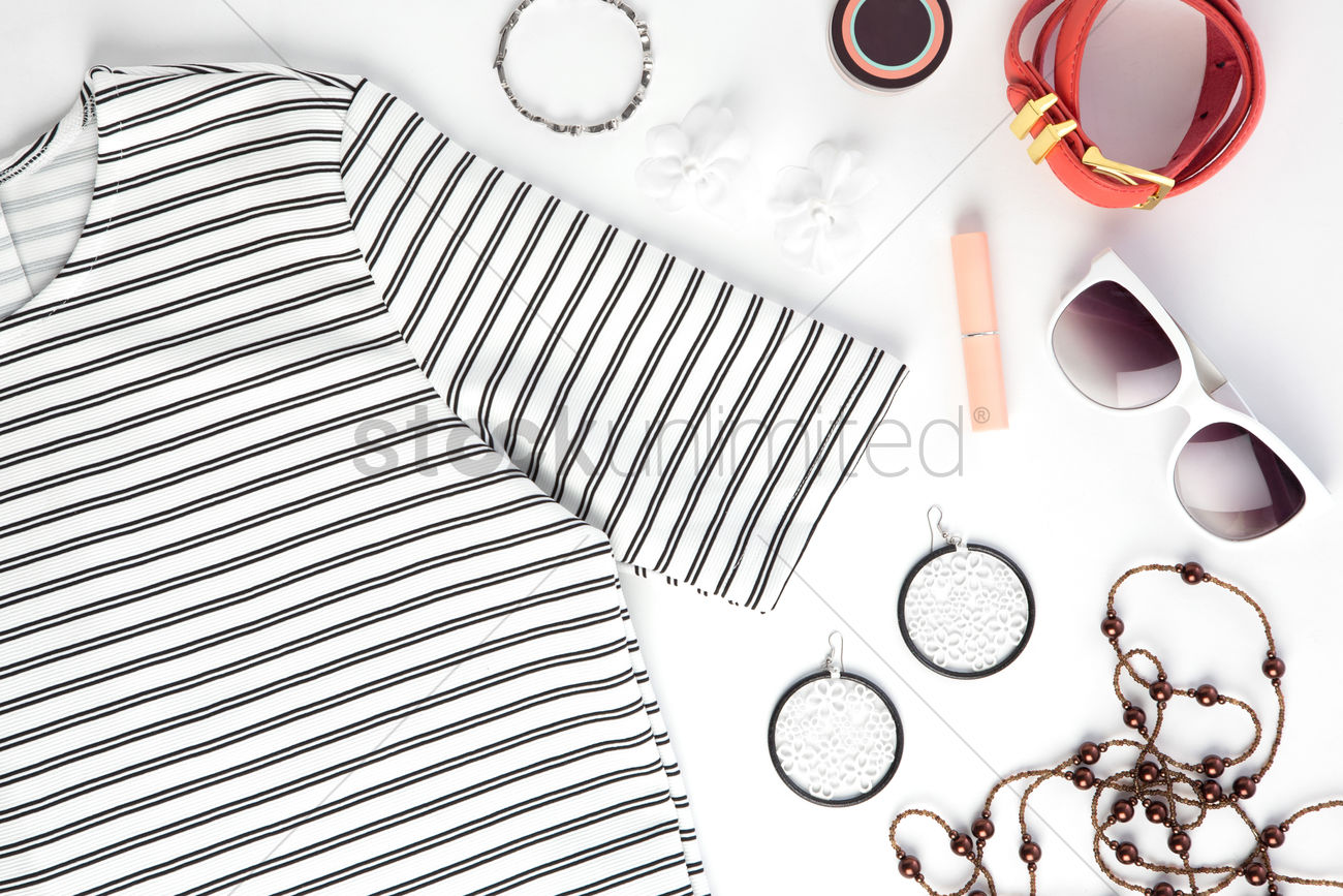 Womens clothing and accessories on white background Stock Photo 1300x867