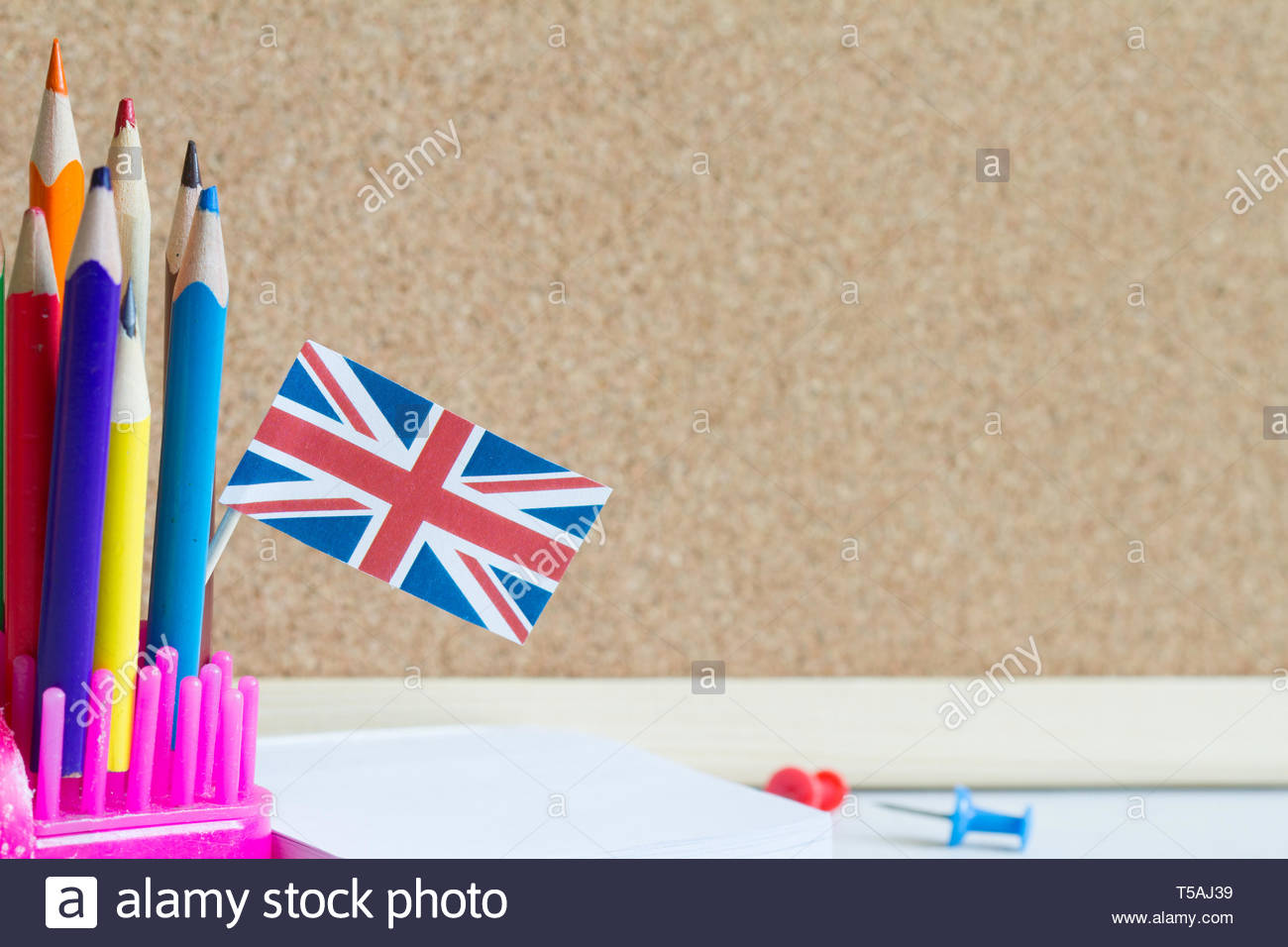 Learning speaking and teaching english with british flag abstract 1300x956