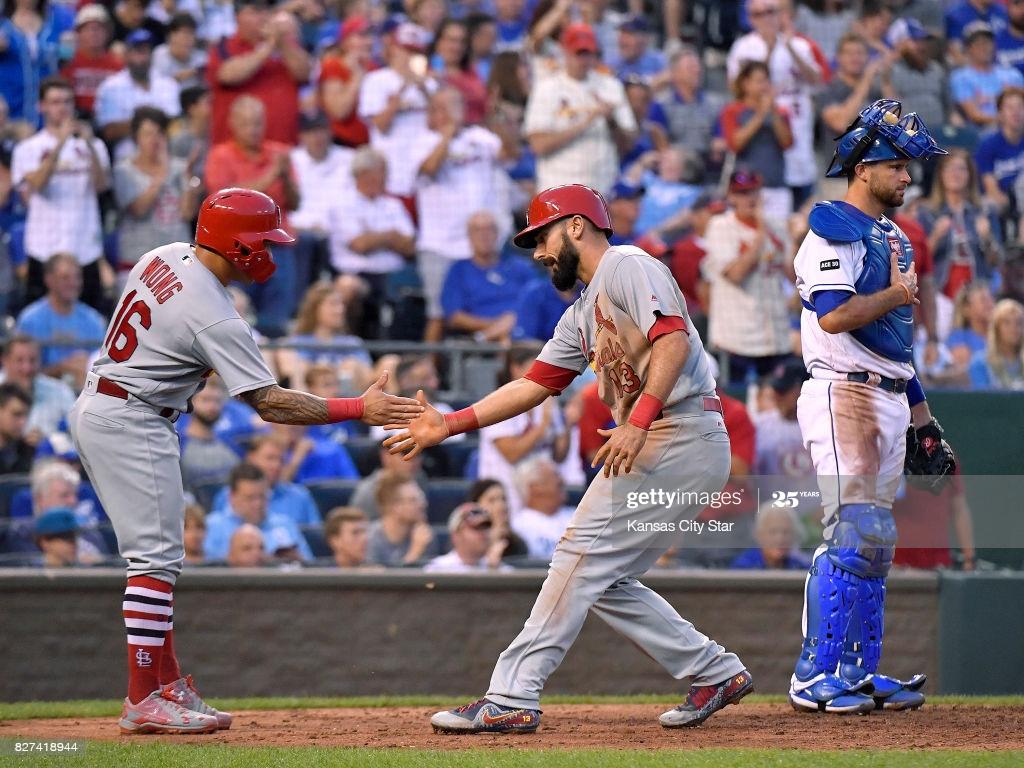 St Louis Cardinals Matt Carpenter is congratulated by Kolten 1024x768