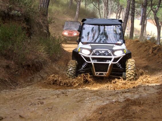 Polaris Side by Side ATV crossing mud bog at the Polaris ATV Speed 567x425