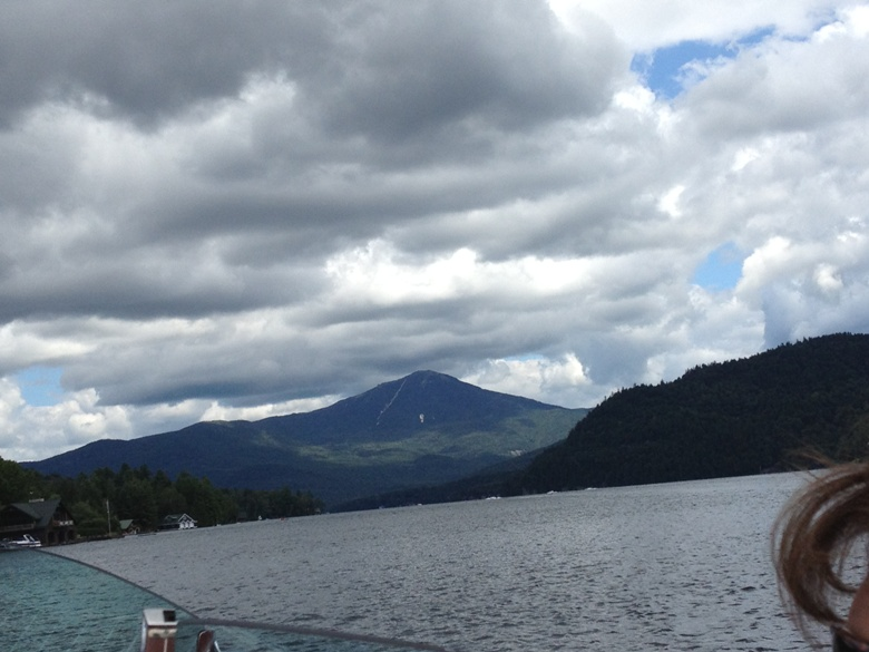 Touring Lake Placid by boat with Whiteface Mountain in background 780x585