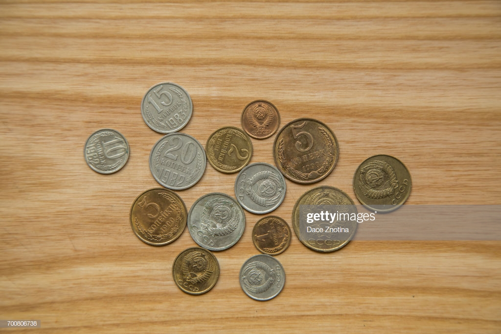 Old Soviet Couns On A Wooden Background Hisoric Used Currency 1024x682