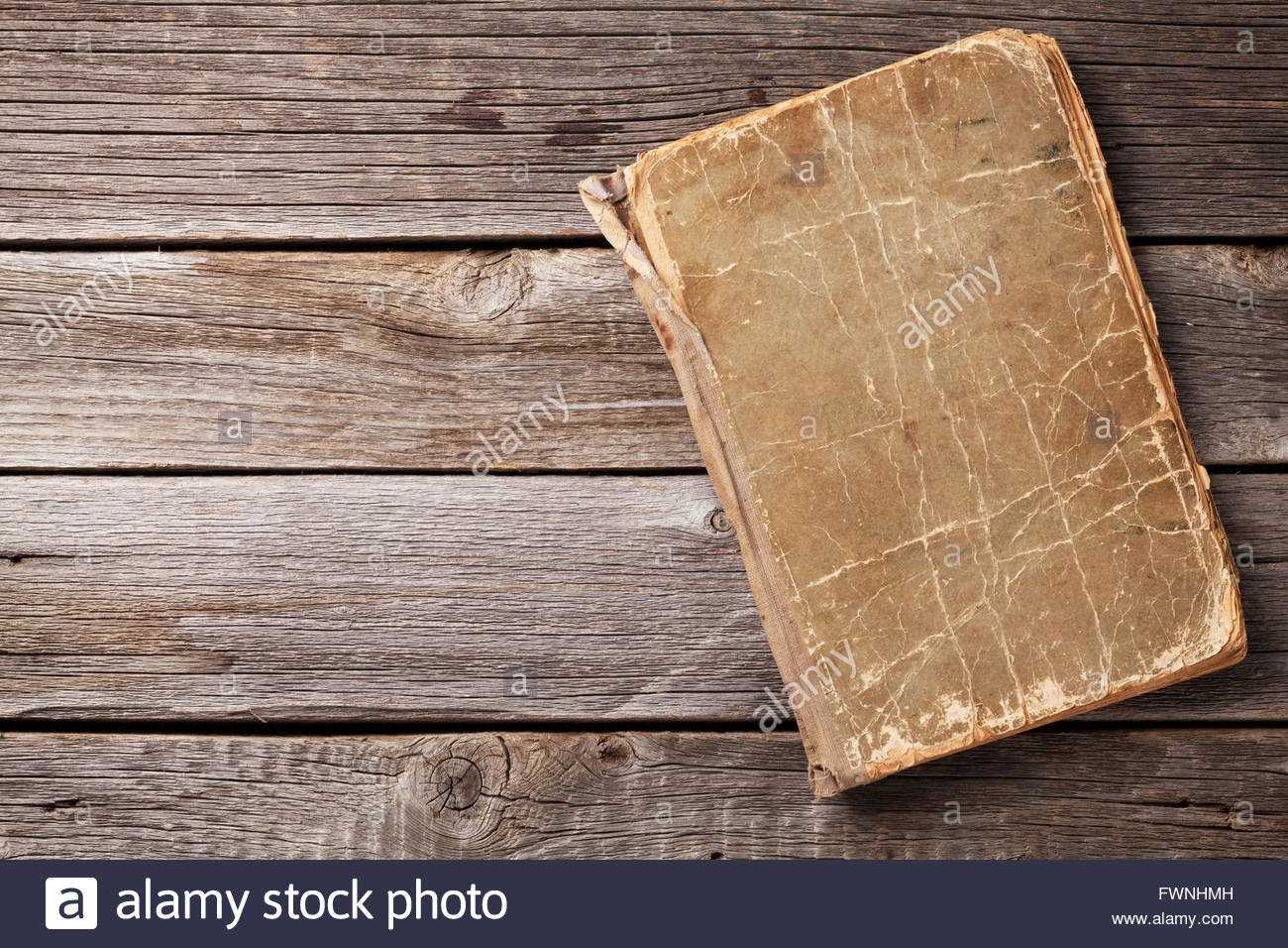 Vintage book on wooden background Top view with copy space Stock 1300x956