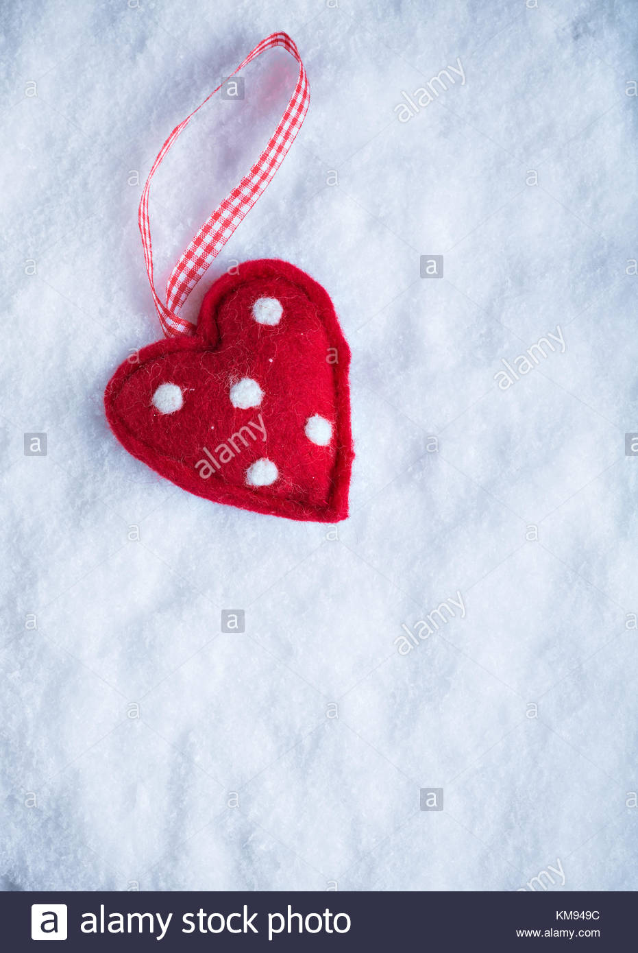 Red toy suave heart on a frosty white snow winter background Love 931x1390