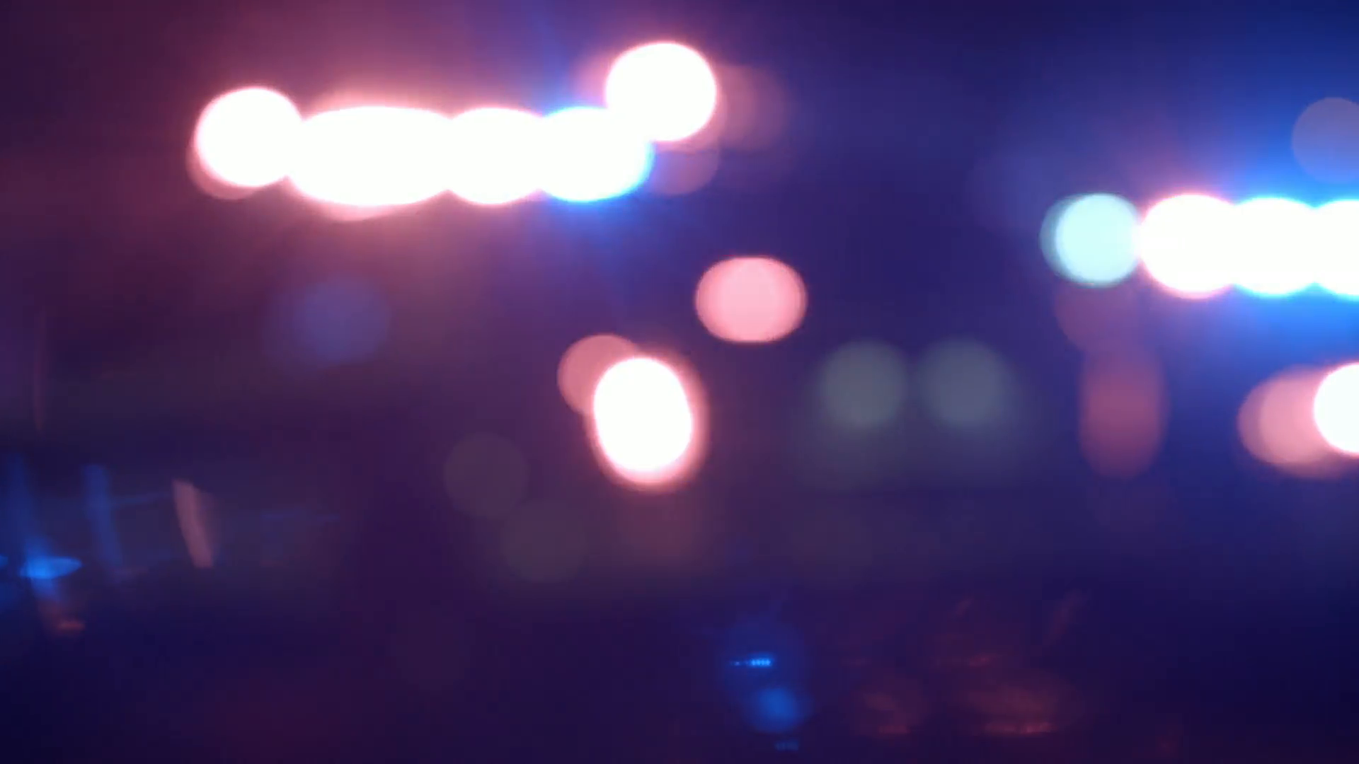Ambulance Cops and Firetrucks Blurry Lights Panning Background at 1920x1080