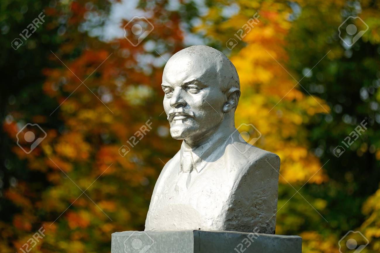 Lenin Bust Monument With Autunm Leaves On The Background 1300x866