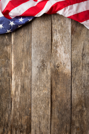 American Flag On Rustic Wooden Background Stock Photo Thinkstock 338x507