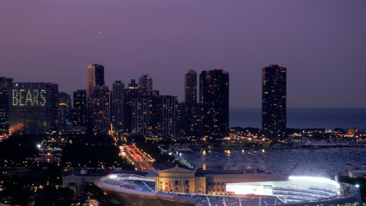 of the New Soldier Field Stadium with the Chicago skyline background 748x421