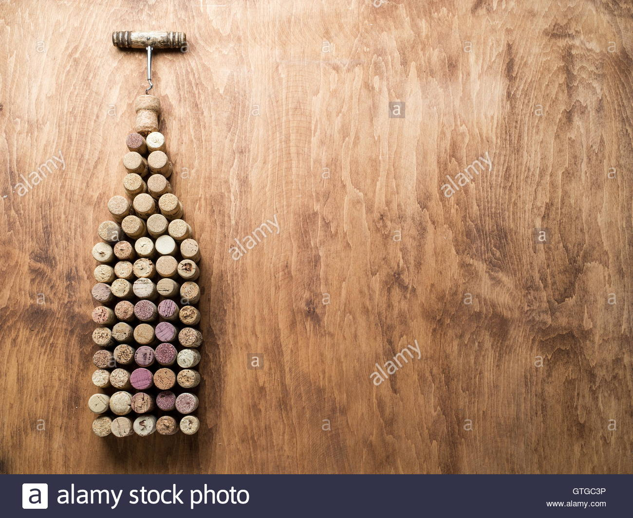 Wine corks in the shape of wine bottle on the wooden background 1300x1065