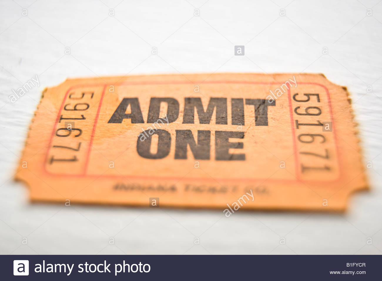 Close up of an orange paper ticket stub on a white background 1300x956