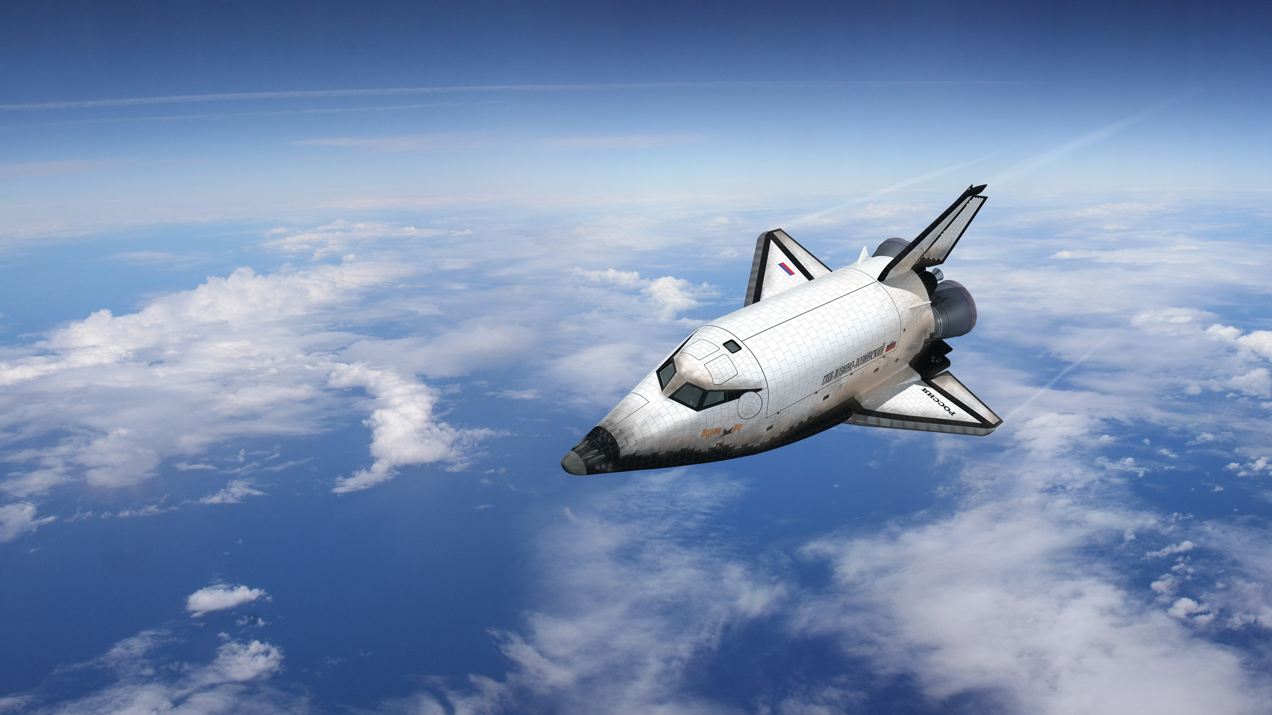 Space shuttle flying over the Earth Wallpaper 2560x1440 resolution 2560x1440