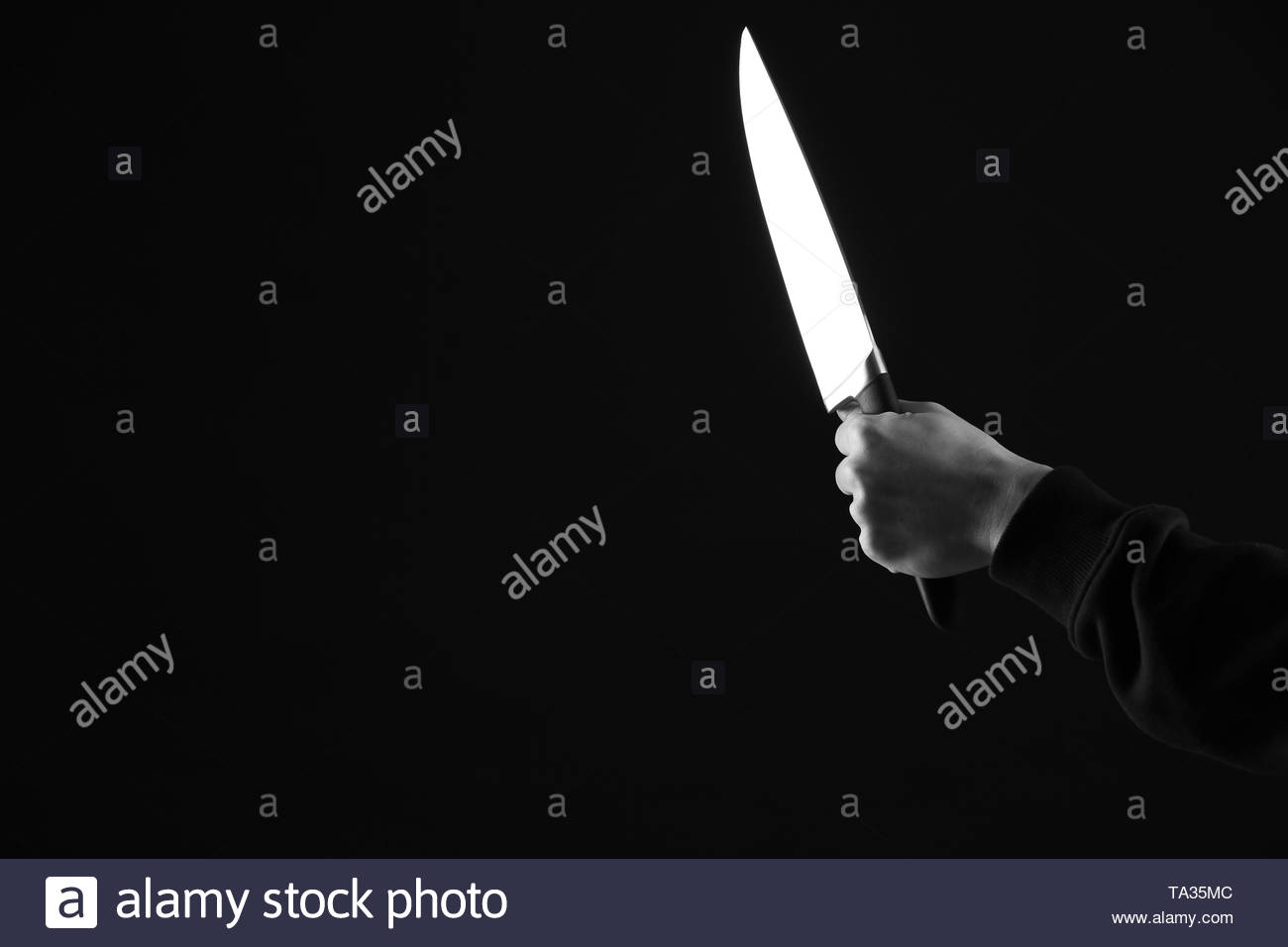 Bandit with knife on dark background Stock Photo 247162060   Alamy 1300x956