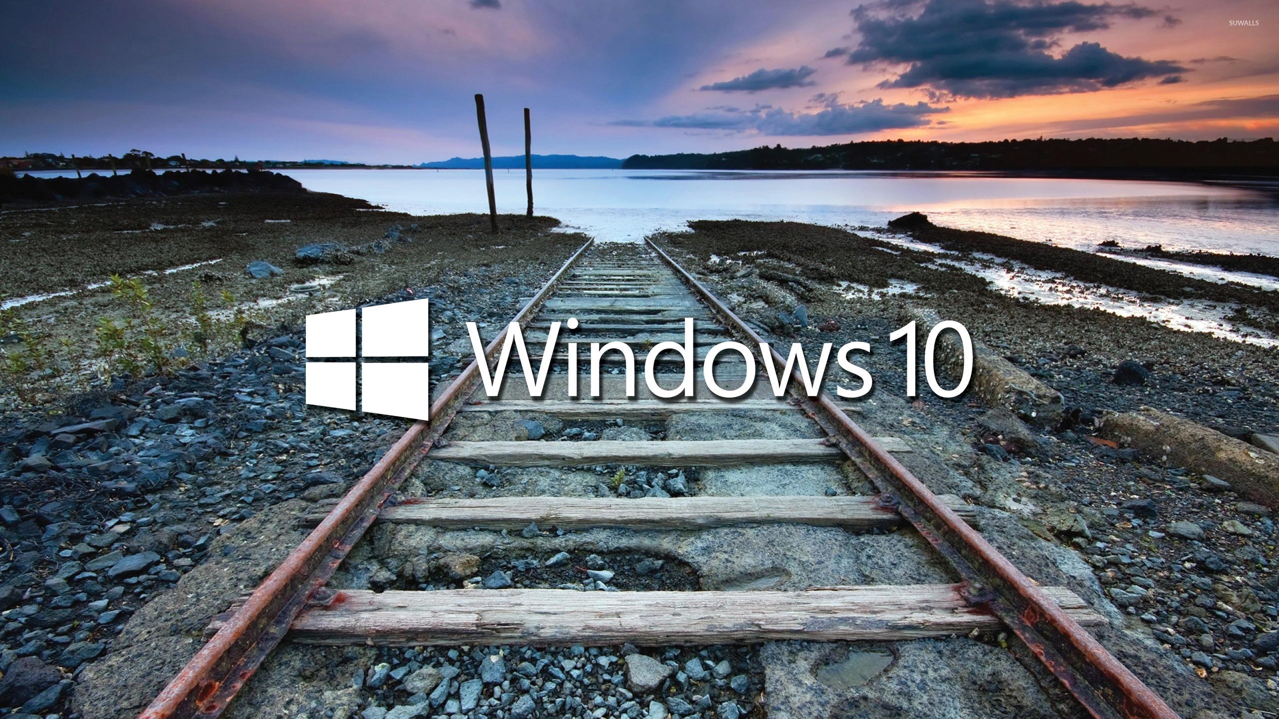 Windows 10 white text logo on the railroad tracks wallpaper 2560x1440 2560x1440