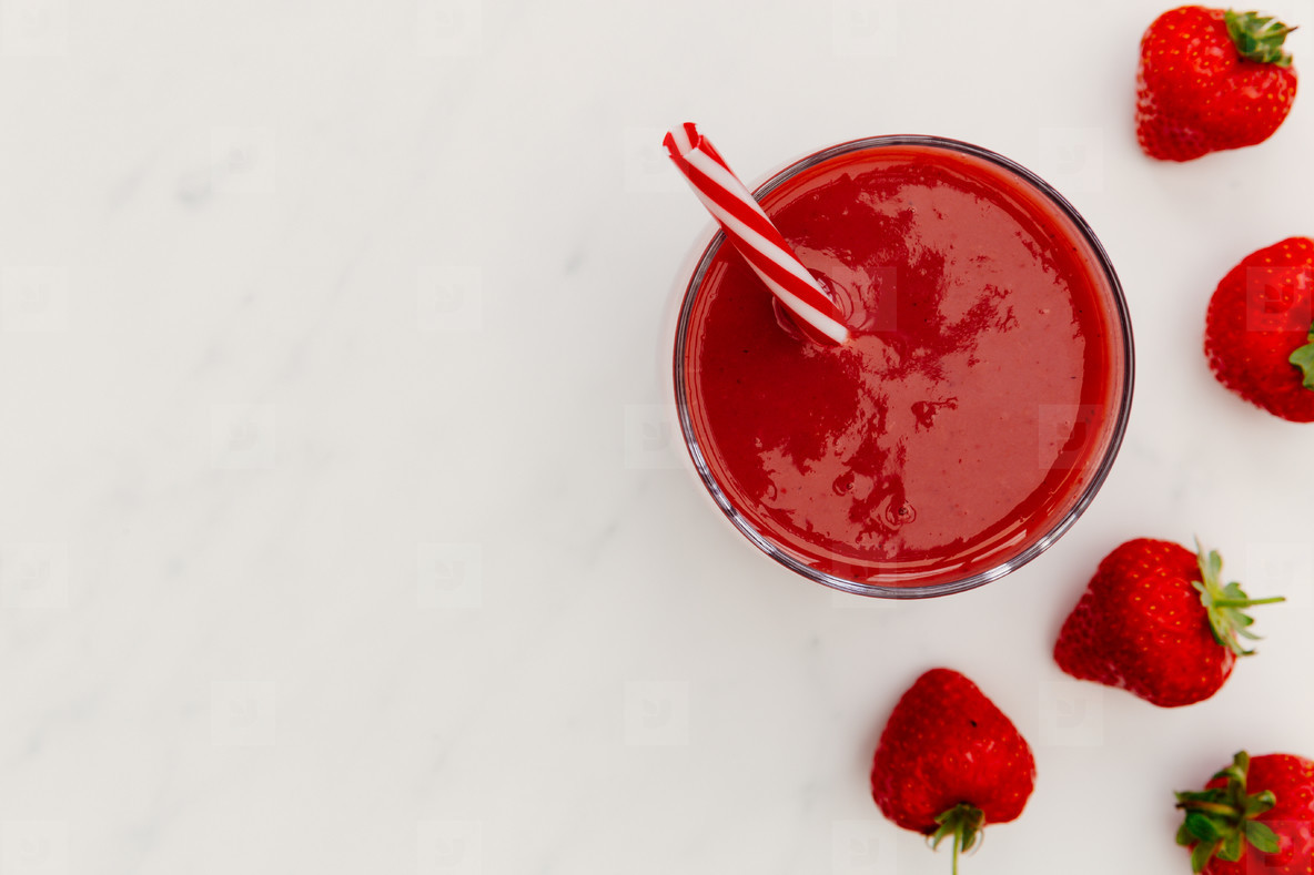 Photos   Red smoothie strawberries drink white background 1184x789