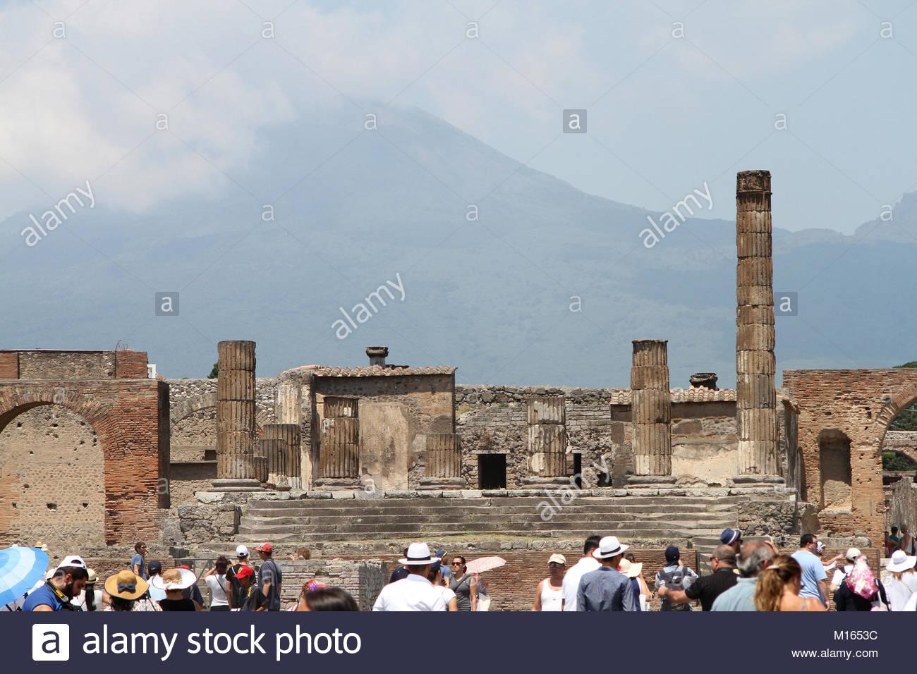 Temple of Jupiter with Mount Vesuvius in the background Pompeii 1300x956