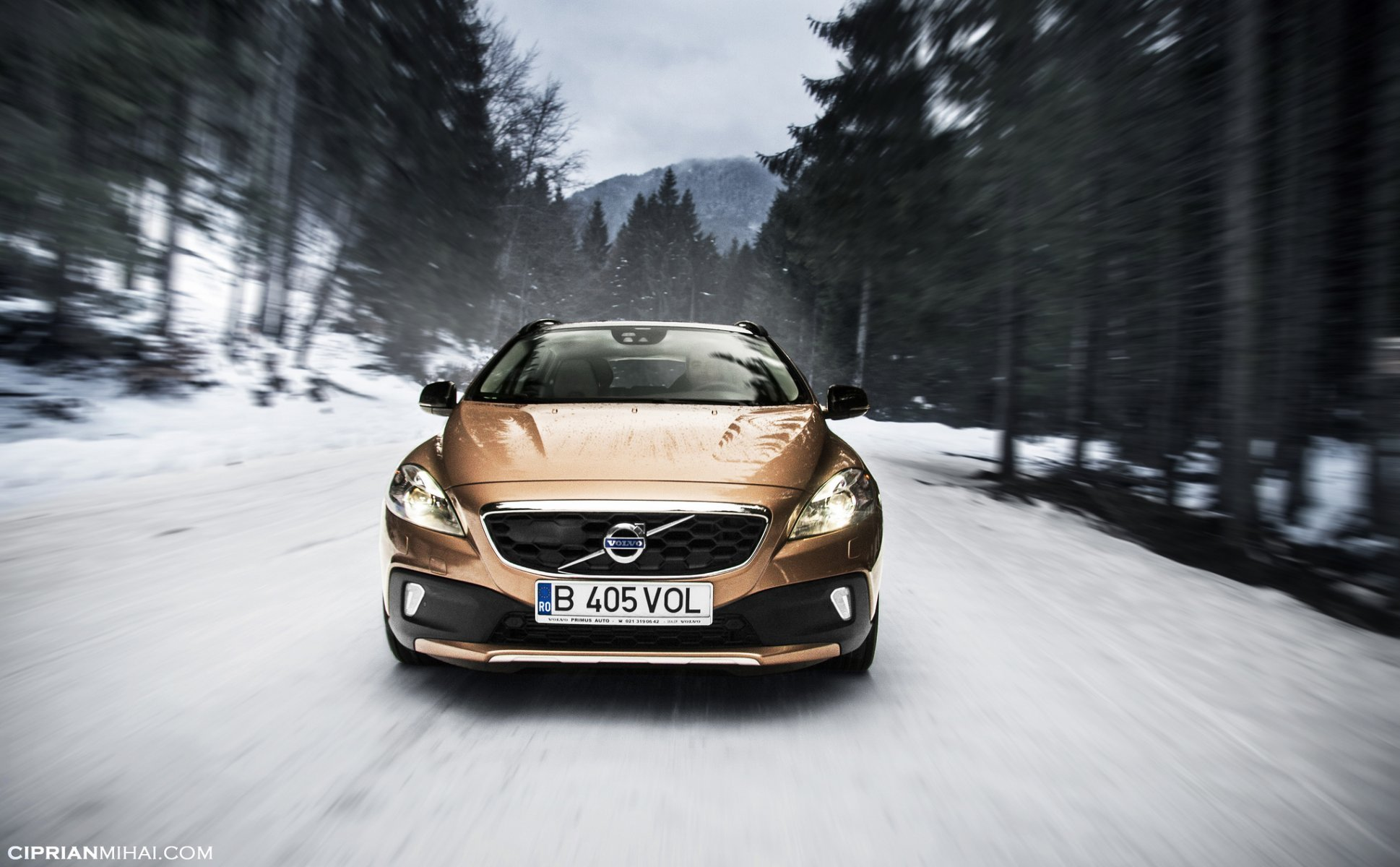 volvo volvo v40 cross country road speed forest winter HD wallpaper 1938x1200
