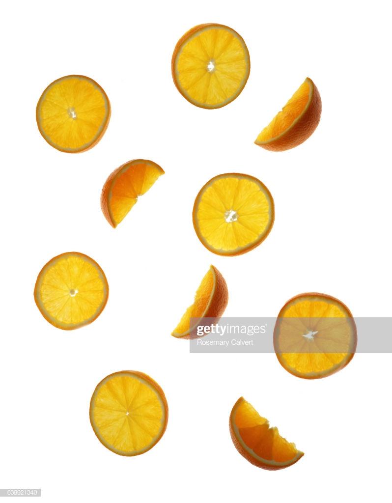 Pieces Of Orange Tumbling Down White Background High Res Stock 798x1024