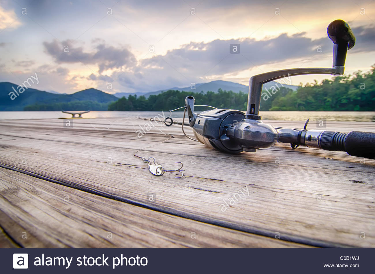 fishing tackle on a wooden float with mountain background in nc 1300x951