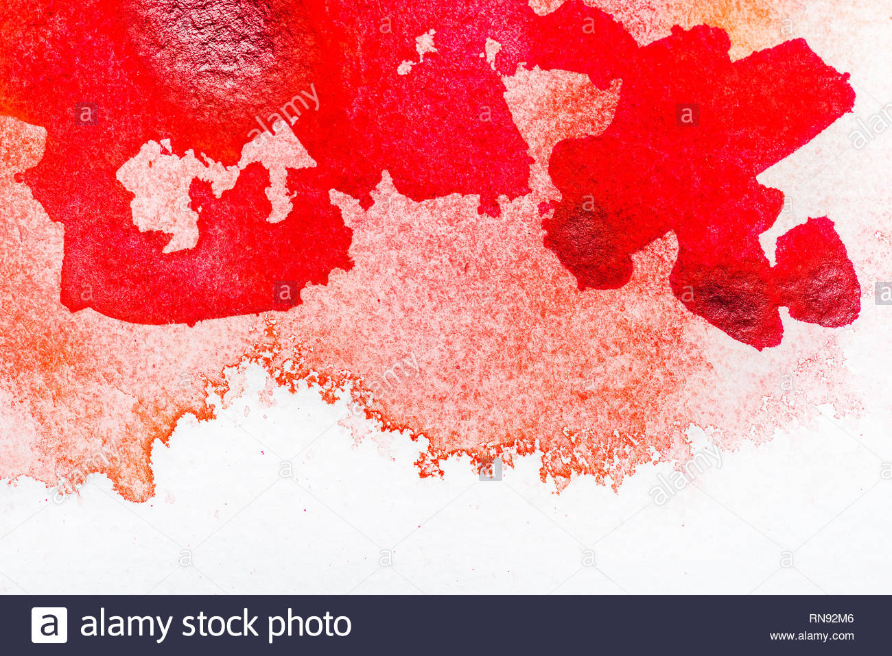 top view of red watercolor spill on white background with copy 1300x957