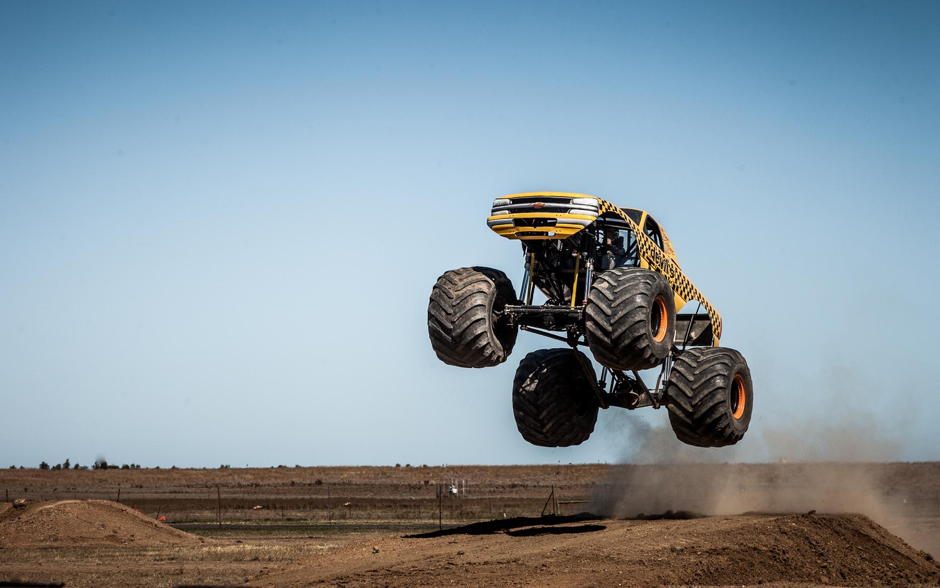 Monster Truck Jump Stop Action wallpaper 1920x1200 1920x1200