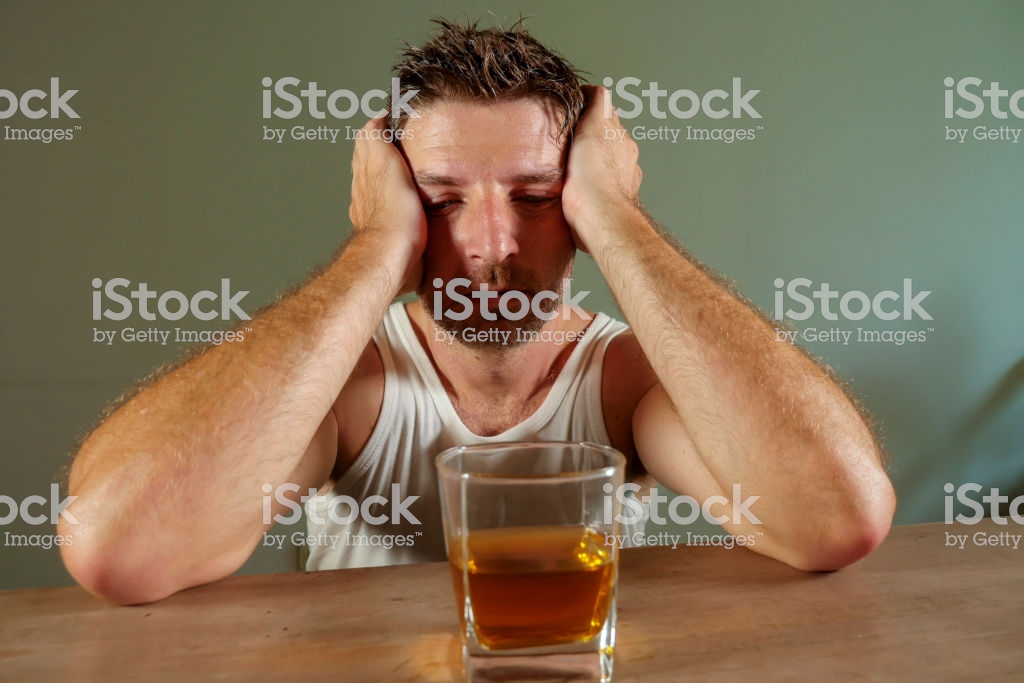 Young Wasted And Depressed Alcohol Addict Man In Dirty Singlet 1024x683