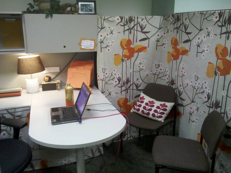 Add interest to bland cubicle walls by using fabric wallpaper or even 800x598