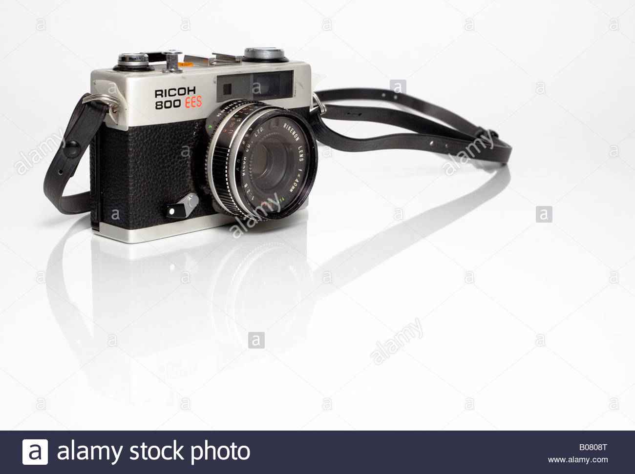 Ricoh 800 Vintage Film Camera with Strap on White Background Stock 1300x971