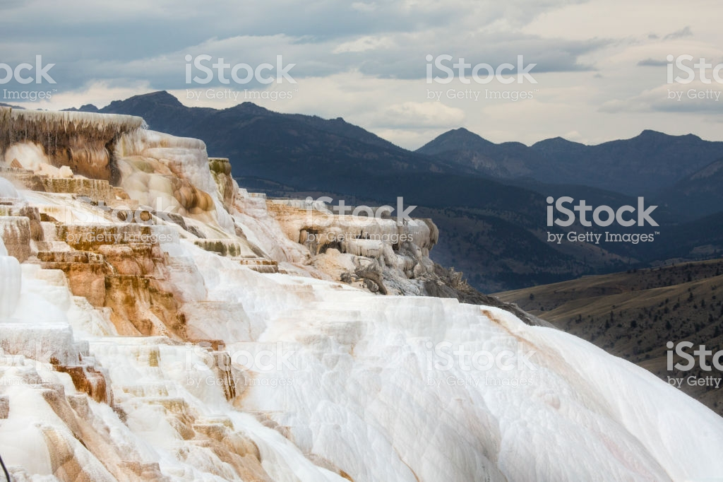 White And Orange Geothermal Terraces With Mountains In Background 1024x682