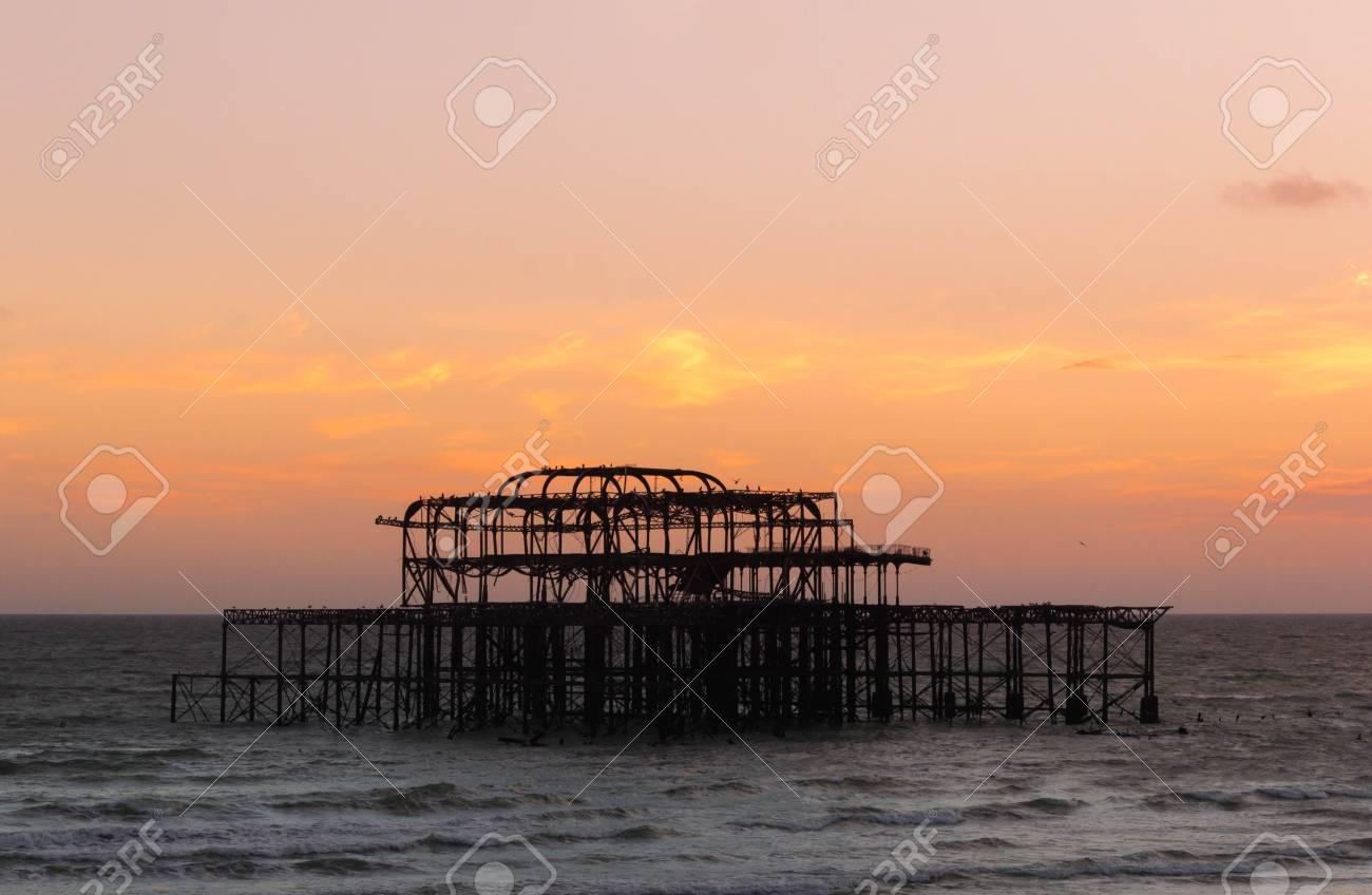 Remains Of Brighton West Pier With Beautiful Sunset Sky Background 1300x848