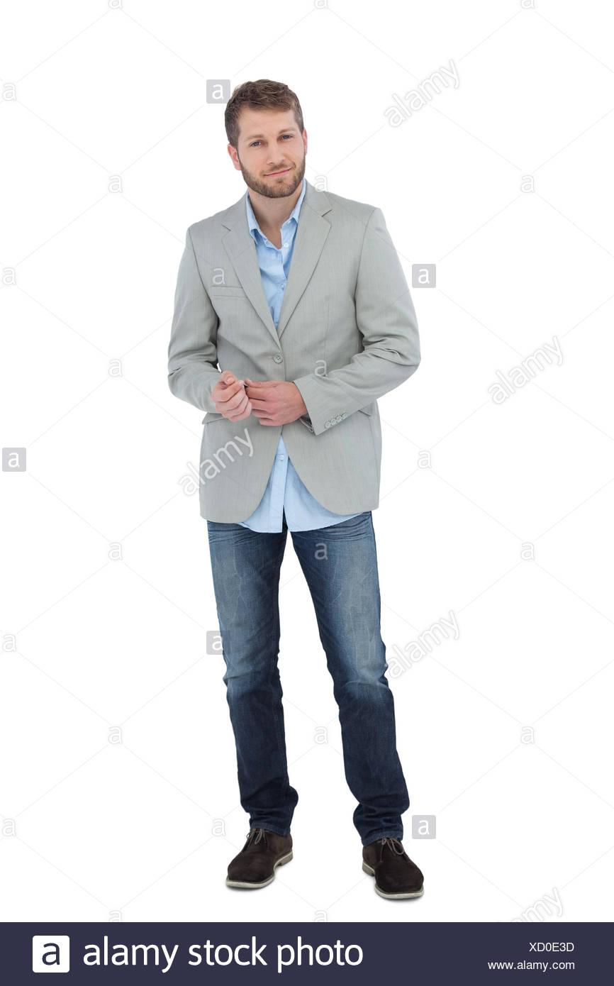 Suave man in a blazer posing on white background Stock Photo 866x1390