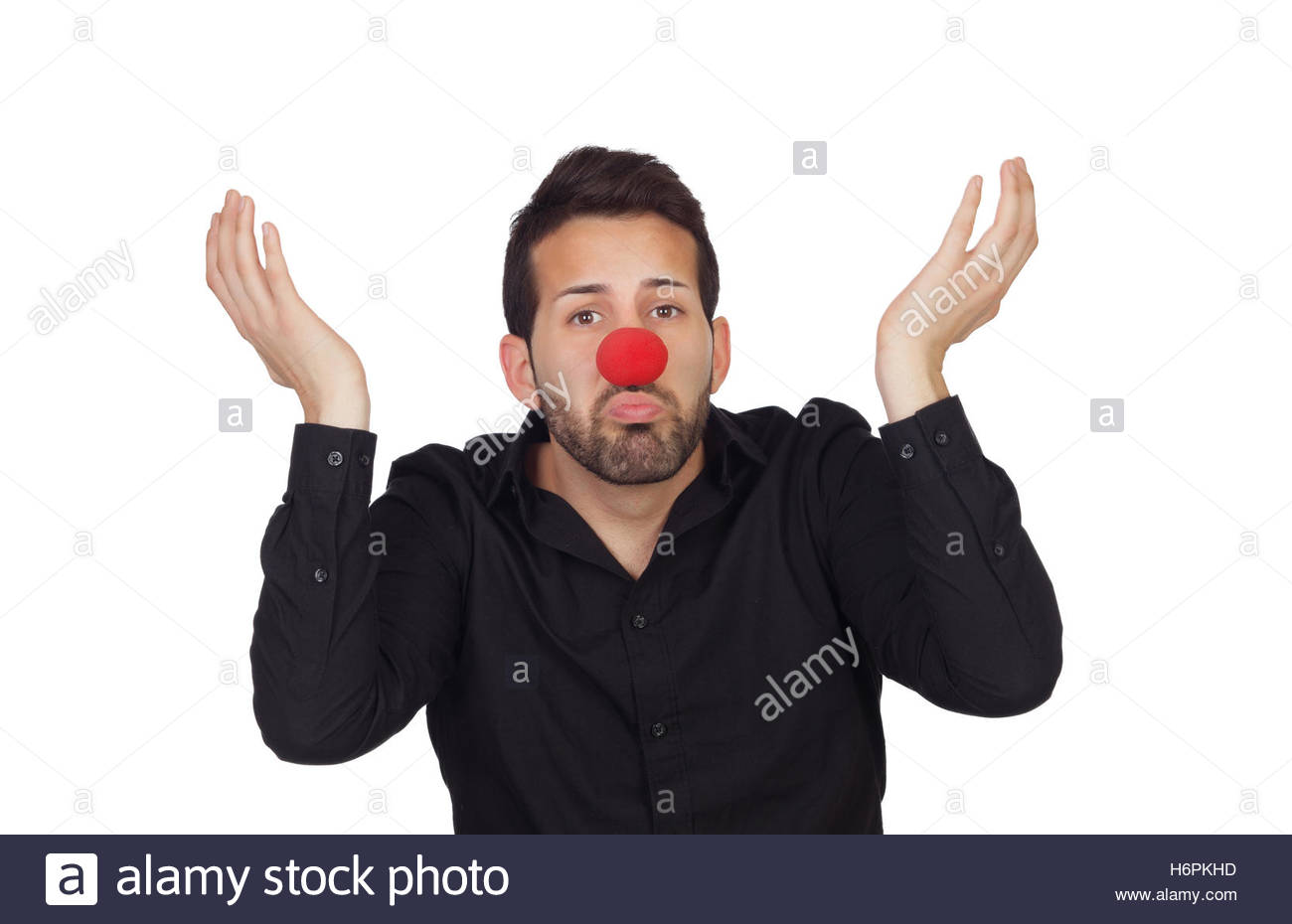 Ignorant businessman with clown nose isolated on white background 1300x930