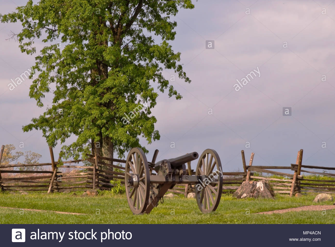 A cannon at Gettysburg National Battlefield with a wooden fence 1300x957