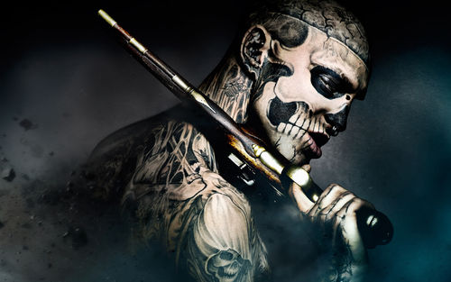 Blackberry iPad Zombie Boy With A Gun Screensaver For Kindle3 And DX 500x313