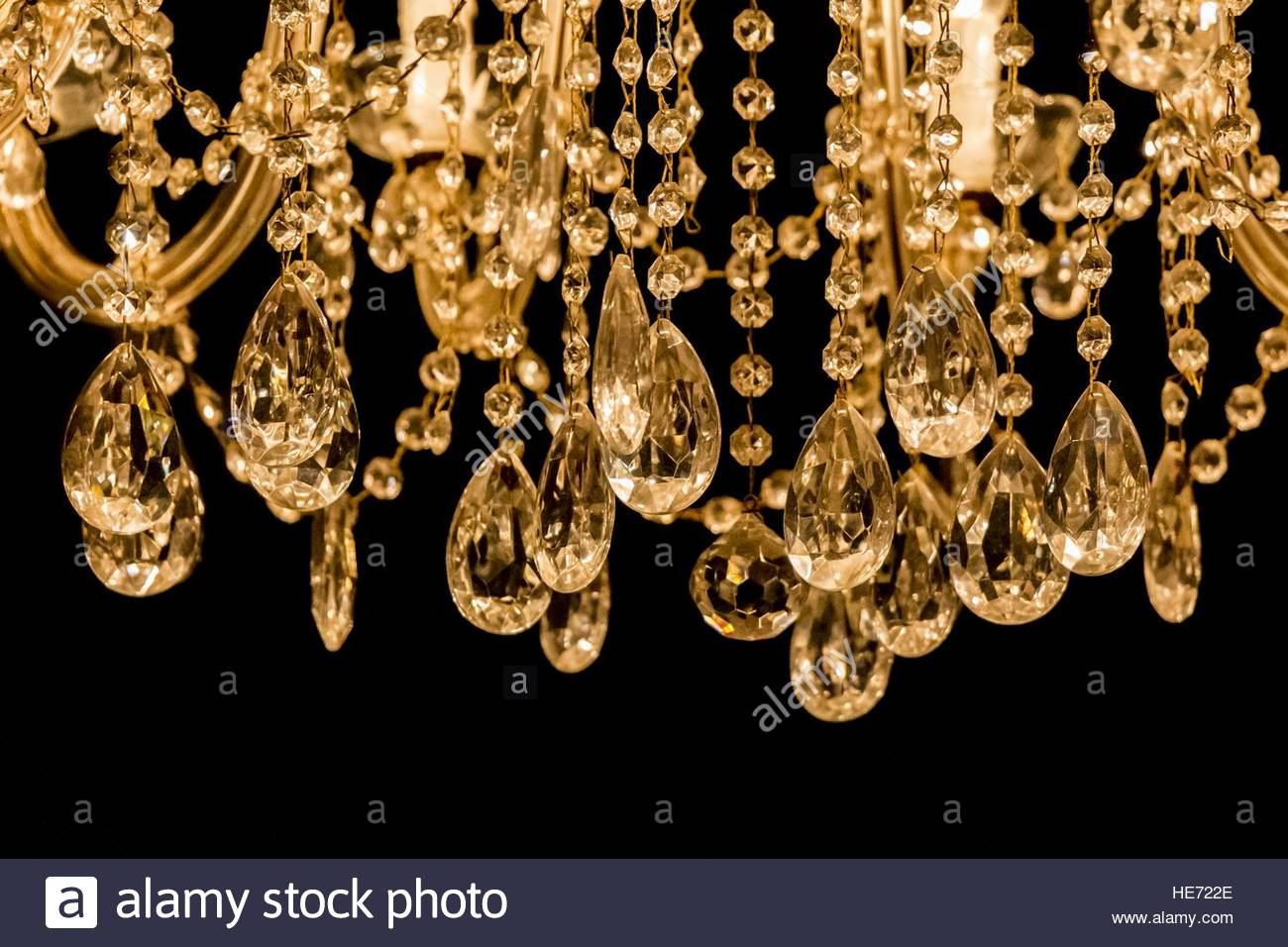 Gallant chandelier with light candles and dark background Luxury 1300x956