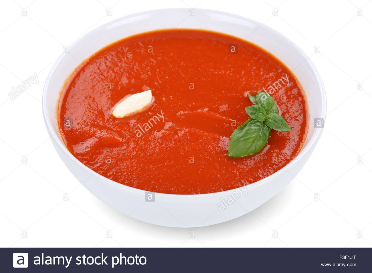 Tomato soup meal in bowl with tomatoes isolated on a white 1300x956