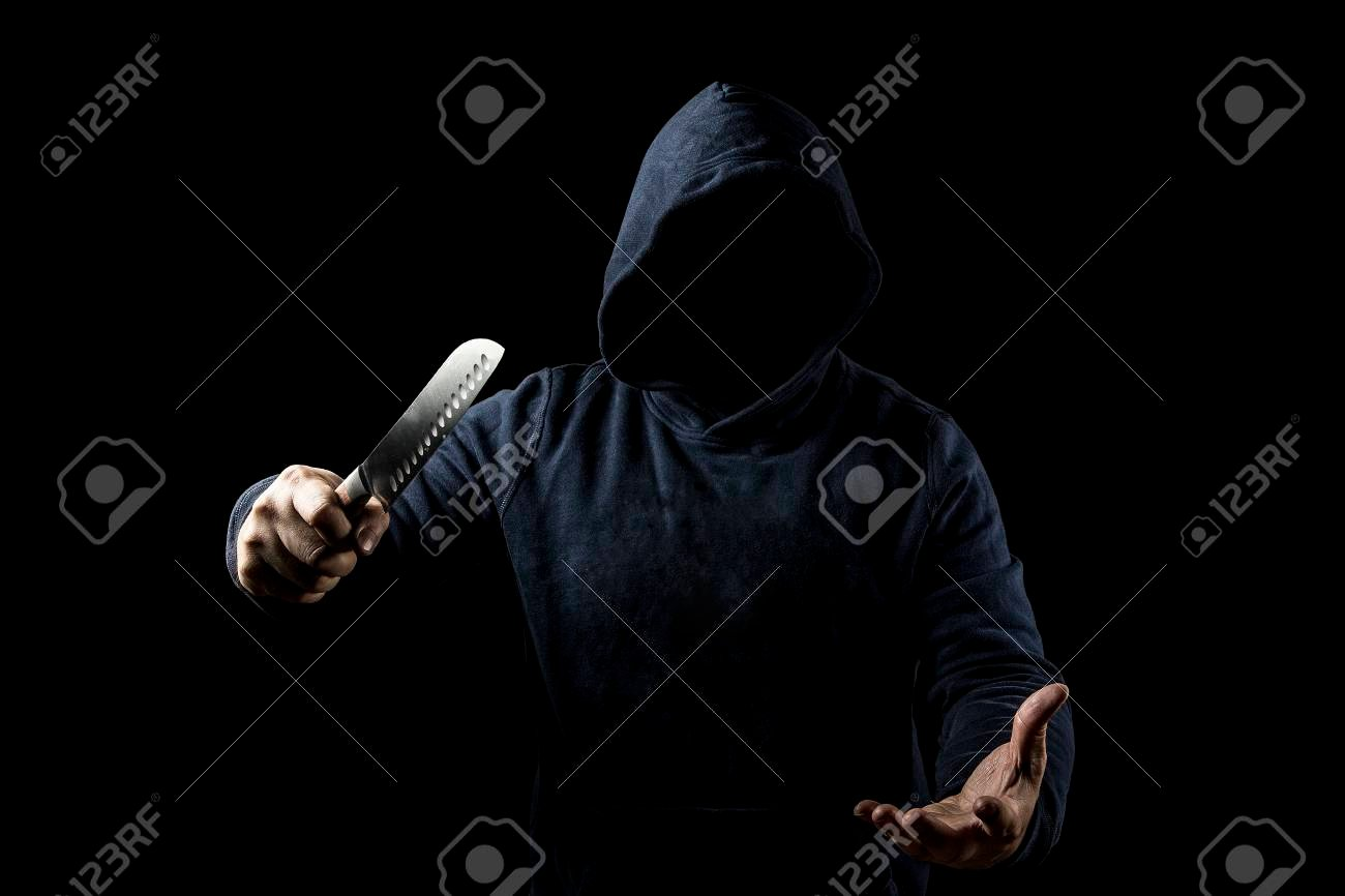 Bandit With Knife On Dark Background Stock Photo Picture And 1300x866