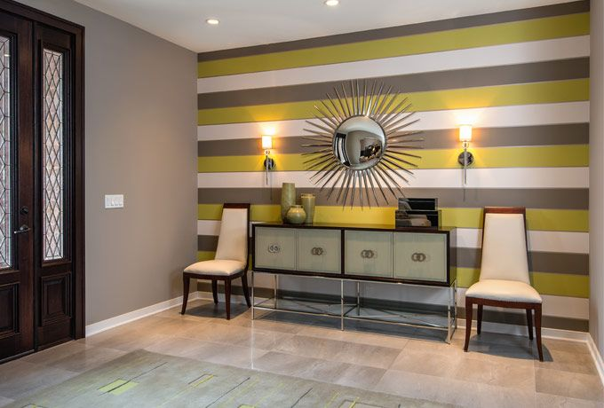 An elegant contemporary foyer with bold horizontal striped wallpaper 680x460